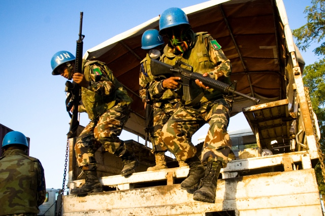 Nepalese troops arrive to provide security for a food distribution at a police station. Port Au Prince, Haiti. Photo by Ben Depp.1/20/2010.