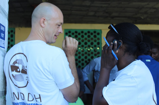 Our fearless team leader, Minerve (on the right) with our driver/experienced observer/co-boss of MCC Haiti, Kurt (left) (Not pictured: our third team leader, Nixon Boumba.)