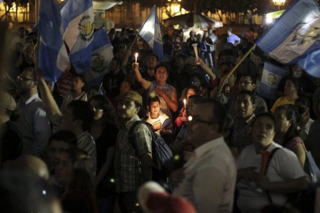 Protesters outside the presidential palace in Guatemala City calling for the resignation of President Otto Pérez Molina and an end to what many see as political impunity. Credit Josue Decavele/Reuters