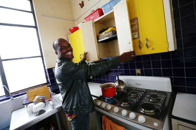 Patrick in the kitchen at Casa de los Amigos, where he used to prepare meals and enjoy time with other migrants and refugees as they adjusted to life in Mexico City.  Nina Linton